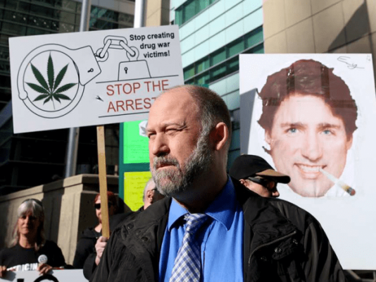 Larsen and his supporters outside the Calgary Law Courts. Image Courtesy of dankr.ca